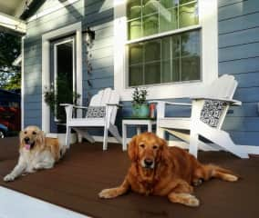 Jessie on the left and Mika on the right sitting on our porch.