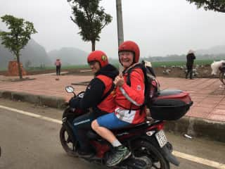 Me (Noreen) in Vietnam on the back of a motorbike!