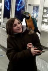 Kathryn with a parrot in Times Square (March 2020)