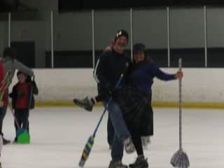 Playing broom hockey with friends