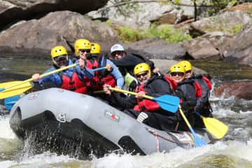 Gregg and Debra with friends whitewater rafting