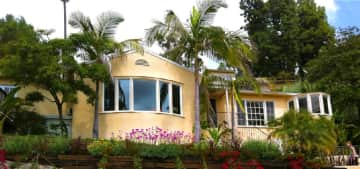 Modest, charming 1700 sq ft 1939 home w/ 2 bed, 1.75 bath, with million-dollar sunny southern views over the city.