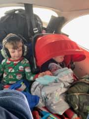 Wilder holding sleeping Everett's hand on a flight home.