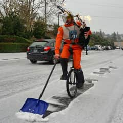 Our bagpipe unicycler who apparently shovels snow too.