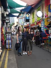 Charis and I with her childhood friend in a Singapore market. One of our favorite places.
