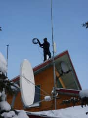 Me, setting up the internet cabling for Blachford Lake Lodge (a wilderness lodge in Canada)