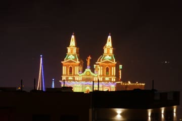 view of church from terrace at night