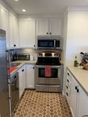 The kitchen includes stainless steel appliances and all the cooking supplies you might need. You are welcome to use our espresso machine!