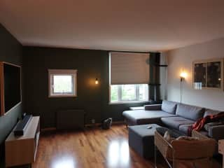 """Spacious living room with 65"""" TV and playstation 5."""