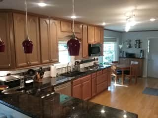Large, well-stocked kitchen and breakfast nook