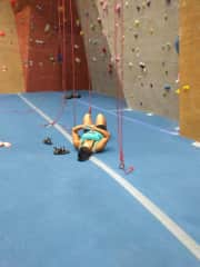 Taking a break between climbs at my local climbing gym