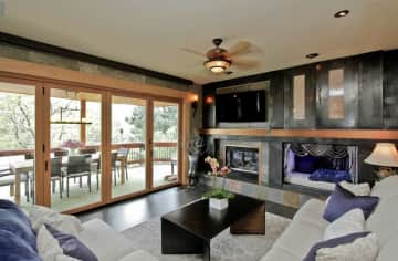 Living area with doors that open to deck