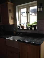 The kitchen is at the back of the house and much brighter than this picture indicates. There is no microwave but there is a coffee maker, gas hob, oven, dishwasher, electric kettle toaster and all the pots and pans you would need for cooking.