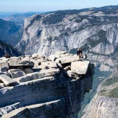 climbing half dome after thru-hiking the John Muir Trail in California this summer