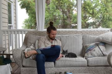 Rad with his family's purfect cat, Katherina.
