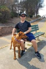 Ryan with his brother's rescue Ridgeback, Angus.