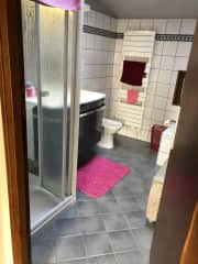 Guest bathroom with wash basin, bidet, shower and bath. Separate WC next to the bathroom.
