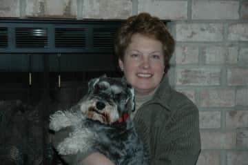 Valerie with Scoonie, trained as a therapy dog to visit nursing homes and hospice care.