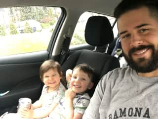 Brent drinking tea with the kids in our car (per their request)