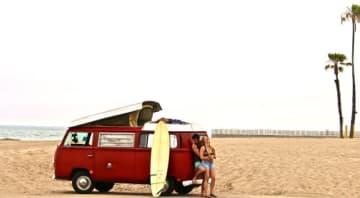 Ali, Joe and Rusty the 1969 Love bus at the beach