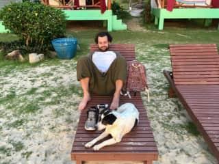 Ben with our friendly little beach dog friend in Thailand!