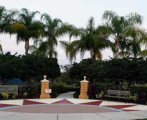 Entrance to neighborhood recreation park to tennis courts, playground, small and large dog park and water fountain park.