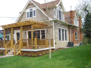 Back yard with great deck, trampoline and gas fireplace