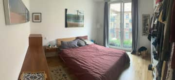 Compfy double bed and we will make some space for your stuff of course. In the window you can see the nice, green courtyard.