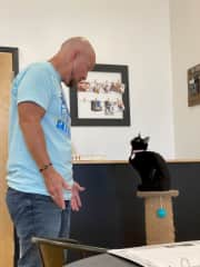 Terry in deep conversation with this little beauty at Pounce Cat Cafe where all the kitties are up for adoption!