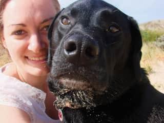 Celia with Labrador Hughey on the beach at Bunbury, Western Australia