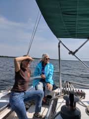 Kim at the helm of Cathexis with daughter Natalie, Lake Michigan