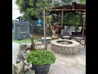 Some of Bill's handiwork...hardscape, firepit and patio w/decking.