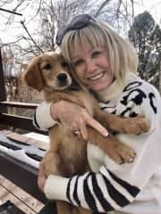 Mary and Captain, her new grand dog.  March 2021