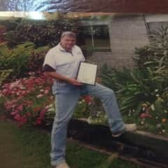 This is a photo of me witha certificate from one of my many garden competition winnnings