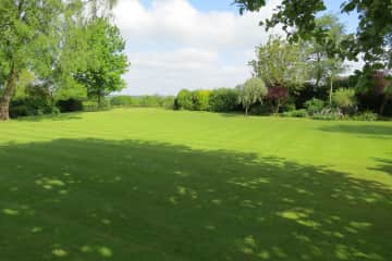 Views across open countryside to walk
