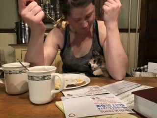 This is me and my cat Waffles, she is trying to swipe (unsuccessfully) some food.