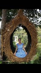 I took at trip to Bali, it was awesome! I'm sitting in a birds nest.