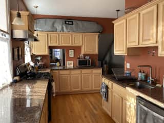 Lots of counter space and everything you might need for cooking/baking! We have an American drip coffee maker and a bialetti stovetop.  Behind the camera is a little room with kitchen table, armchair, fireplace and door to backyard. Pets eat back here.