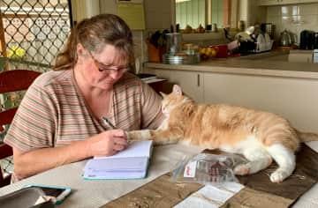 Raffie helping me write in my diary!