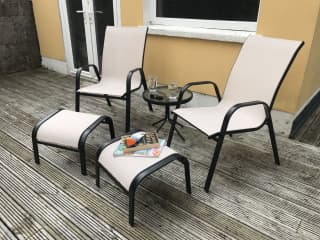 Put your feet up, enjoy a cocktail and some sun on our deck.