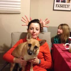Sister in law being goofy as I hold my sister's dog