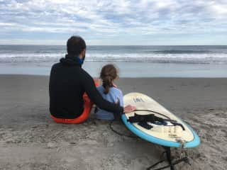 Earl and Lillian at the beach. Earl lives to surf and Lillian wants to learn!