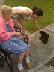 Petting every animal in my path while walking with my grandma!