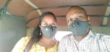 Keeping safe in a rickshaw in Chennai, India