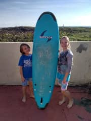 Sara and David with their first surfboard in Cocoa Beach, Florida