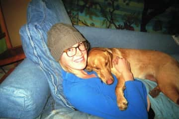 Me with one of my favorite snuggly pups, Daisy.