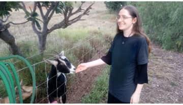 Me caretaking goats (giving out treats)