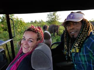 Brina and Wayne have been traveling the world together for 6.5 years - here they are on a safari in Sri Lanka with wild elephants