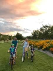 Enjoying a family bike ride in our neighborhood.