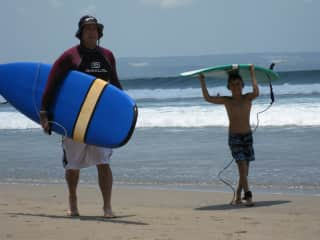 Anthony surfing with Hunter, Bali 2009.